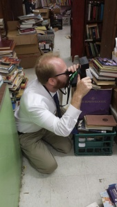 David McCarty taking the photograph of Fred Smith in Choctaw Books.
